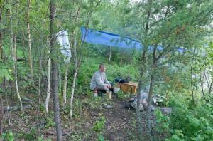 Graeme under tarp at Drinking Lake campsite